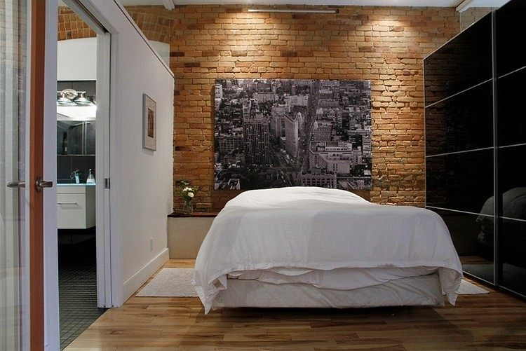 dormitorio pared ladrillo visto suelo