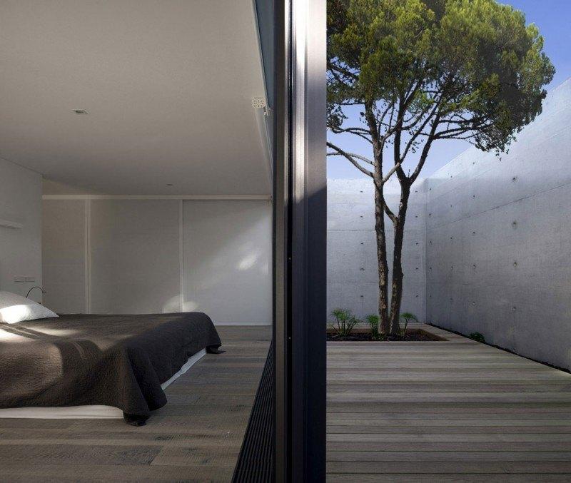 hormigón armado expuesto casa valla jardin ideas