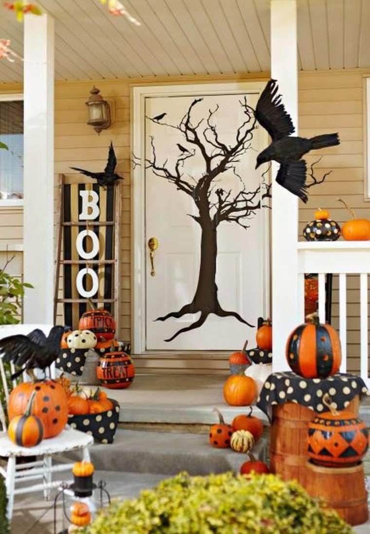 Imagenes de halloween 35 ideas para decorar la puerta - Decoracion calabazas halloween ...