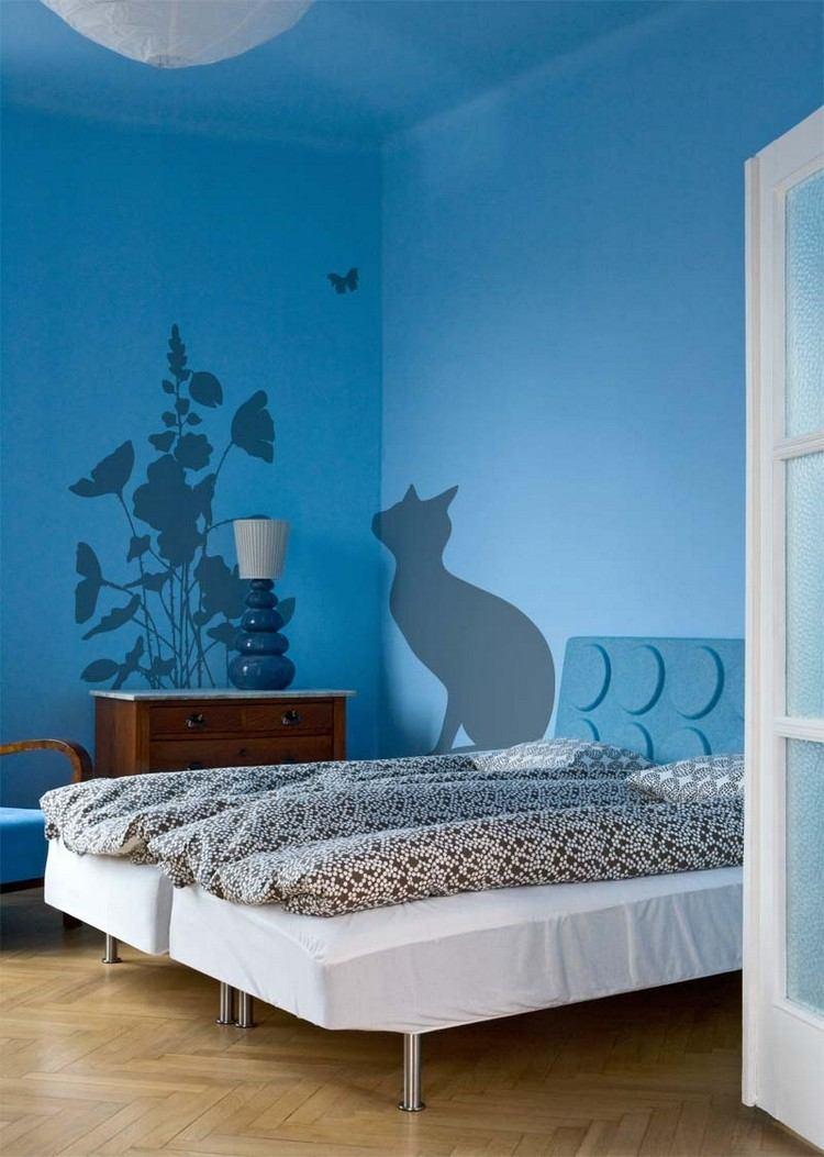 pared color azul silueta gato