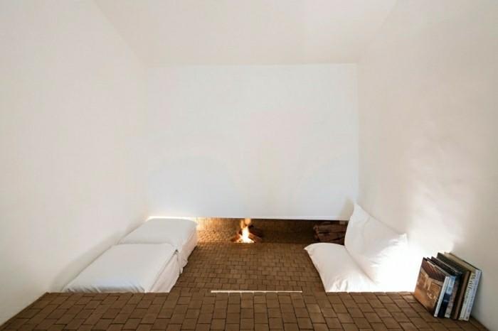 salon minimalista pozo fuego suelo