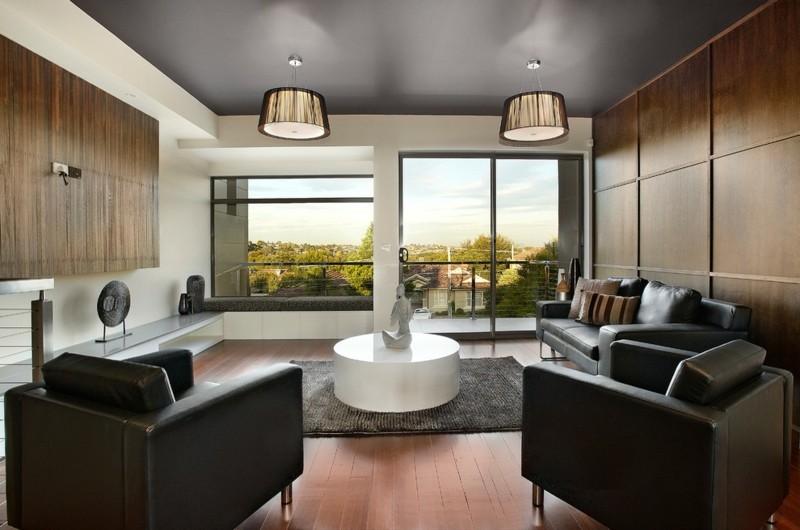 salon moderno paredes color marron sillones negros ideas