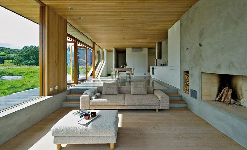 salones chimenea modernos pared hormigon muebles gris ideas