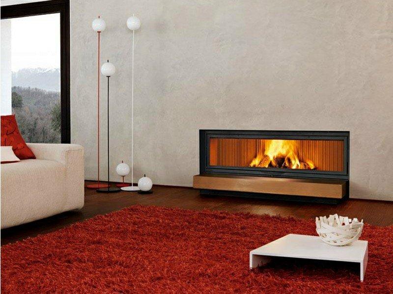 salones con chimenea modernos alfombra roja ideas