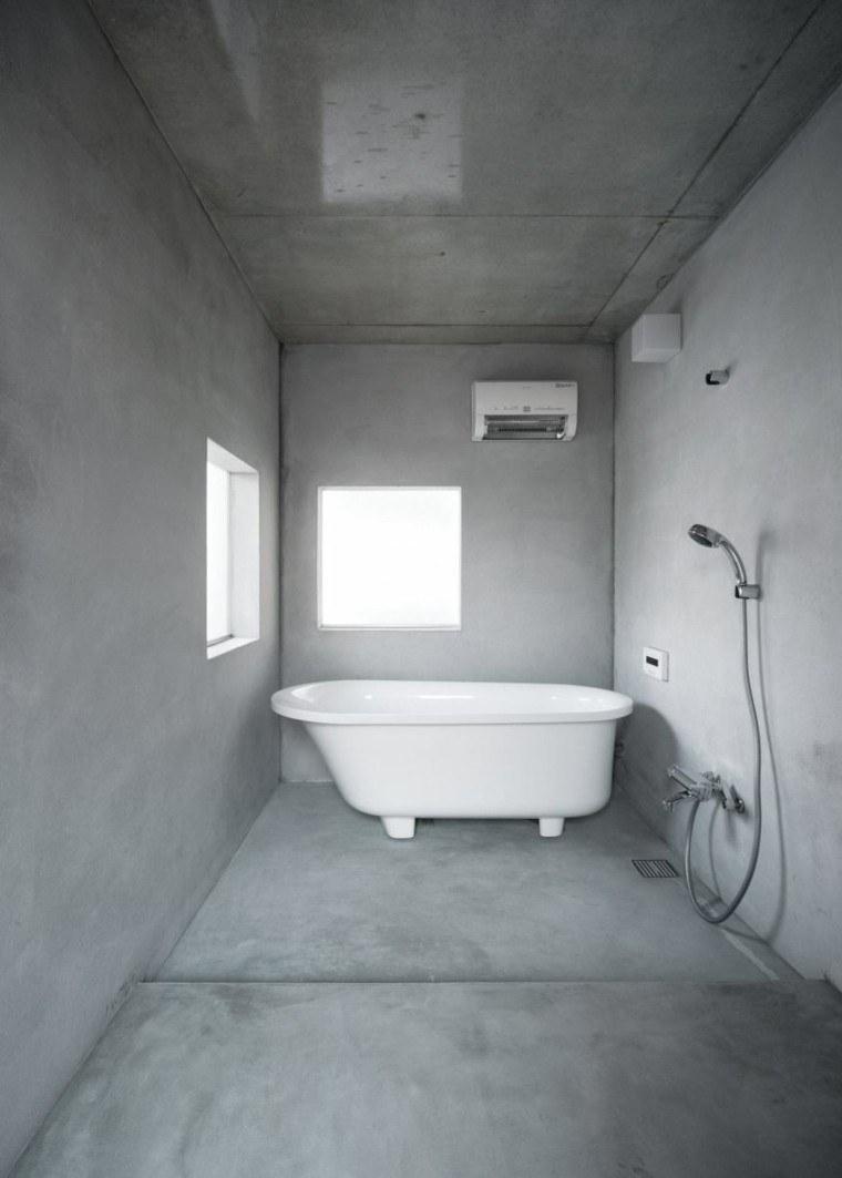 baño estilo minimalista celda cemento