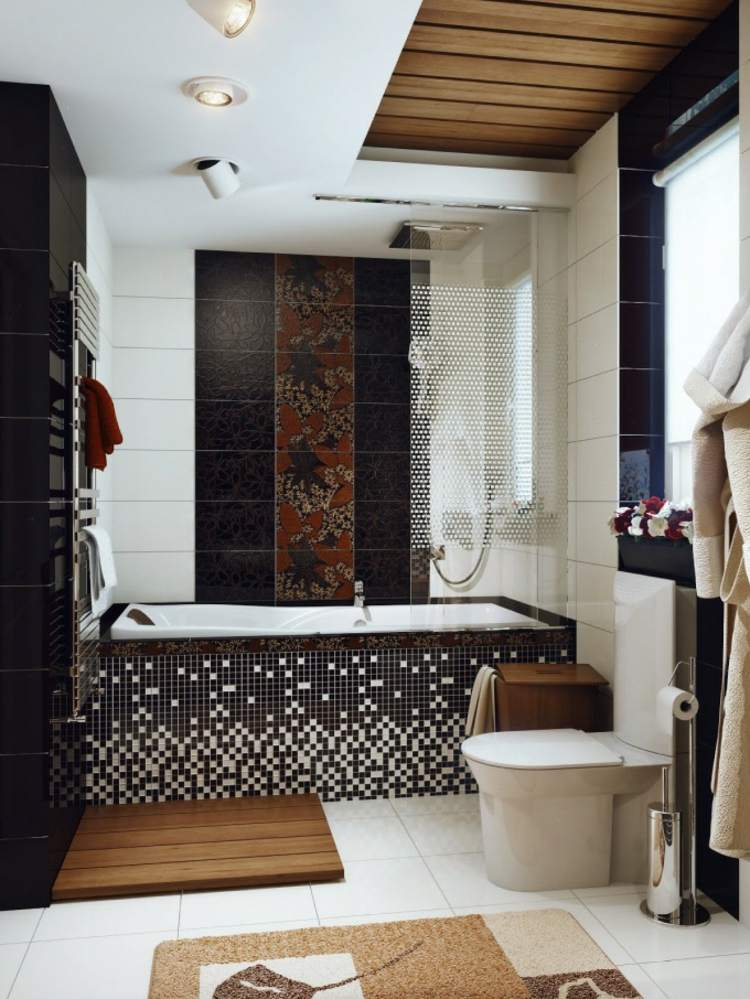 baño pequeño toallas murales listones negro
