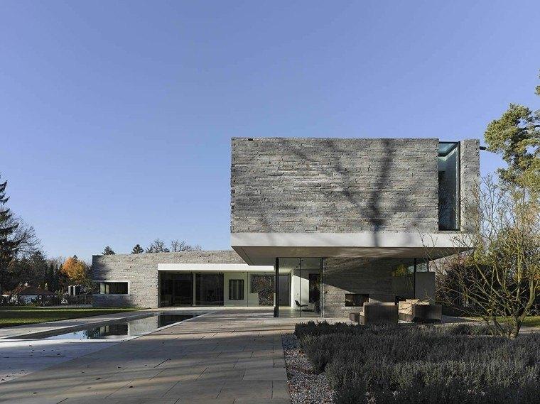 casa moderna fachada piedra gris