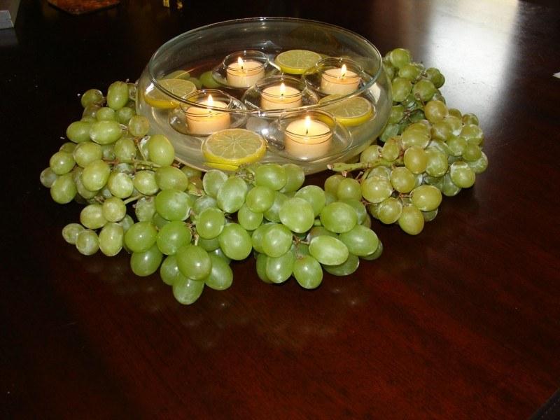 centro mesa uvas velas limones