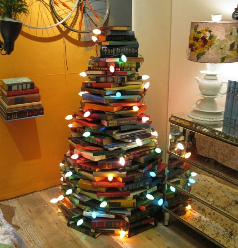 deco abeto libros luces navidad