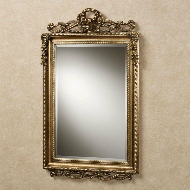 espejo dorado marco forma rectangular