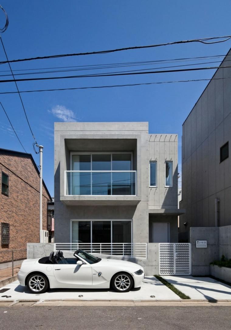 fachada casa cemento color gris