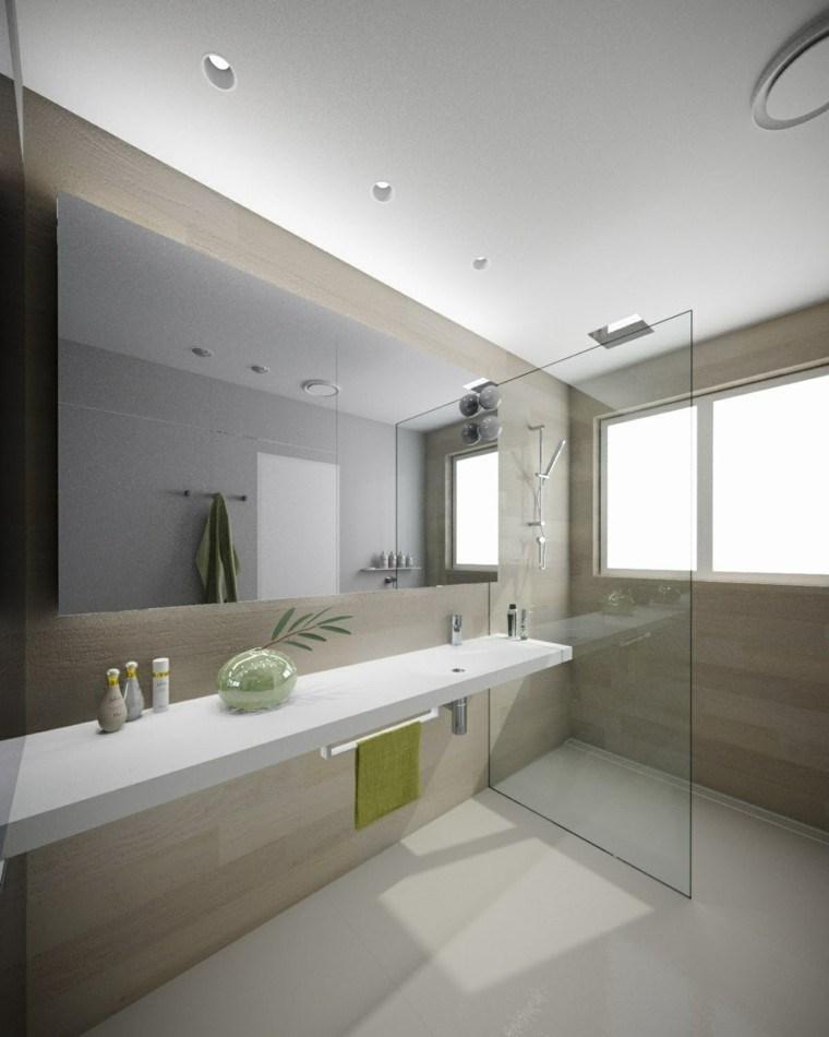 Baños Duchas Modernos:Ducha rodeada por paredes con losas grices diseñado por Minosa Design
