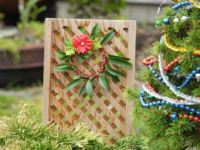 muro madera guirnalda decorar jardin ideas