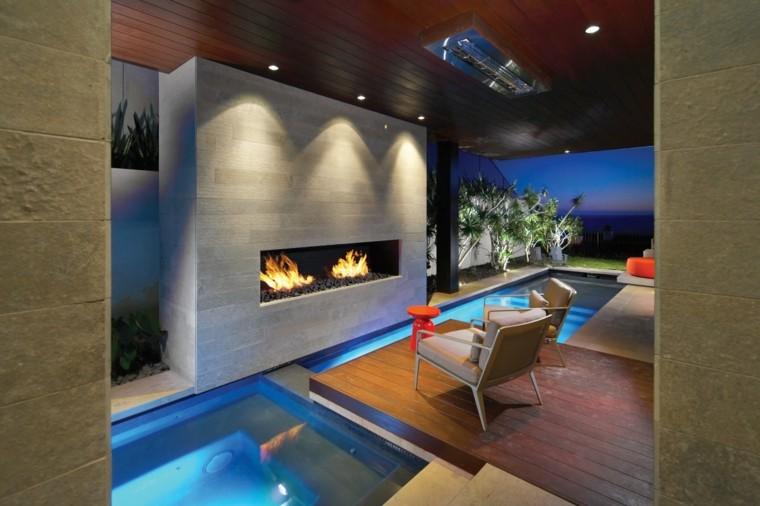 piscina cubierta chimenea moderna