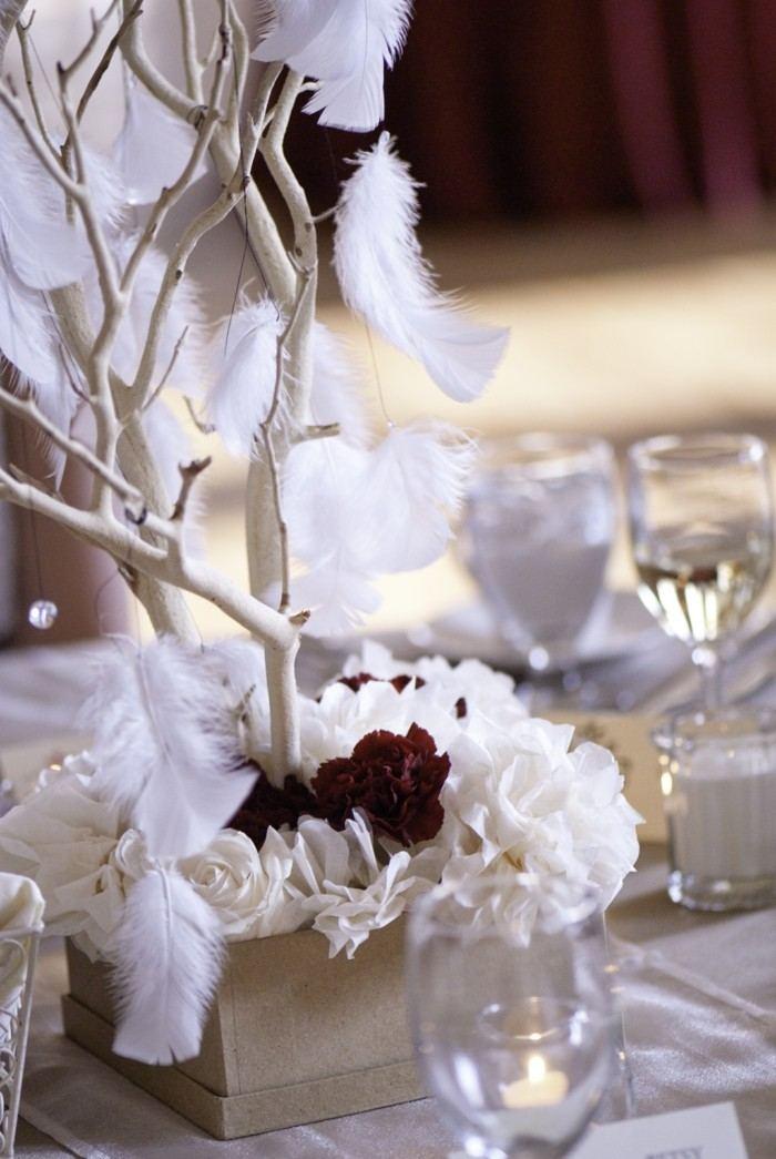 rama madera plumas centro mesa boda ideas