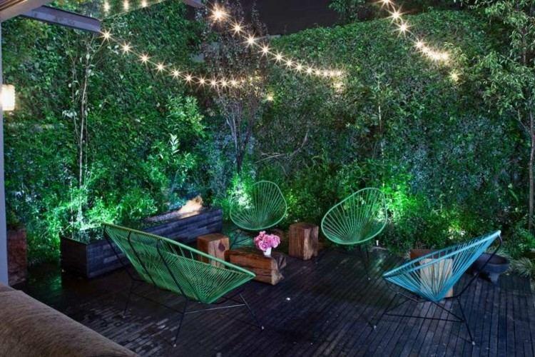 sillones cojines plantas exteriores colorido verdes