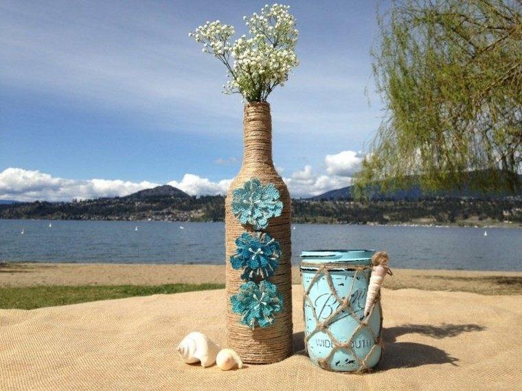 botellas de cristal envueltas hilo flores ideas