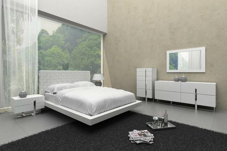 cama blanca pared cemento gris