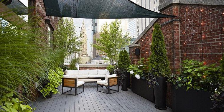 decoracion exteriores terrazas macetas negras ideas