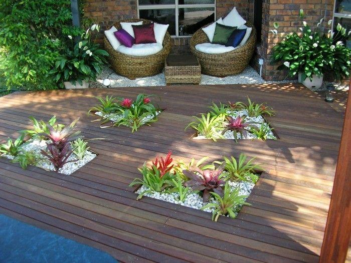 decoracion de terrazas rocas suelos flores