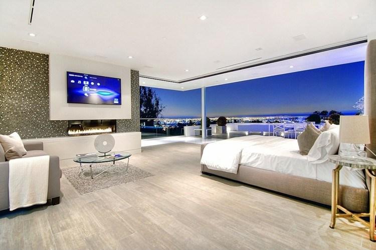 dormitorio vistas ciudad pantalla pared