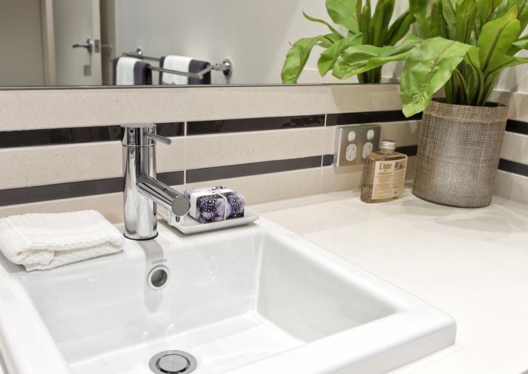esquina mueble lavabo maceta planta