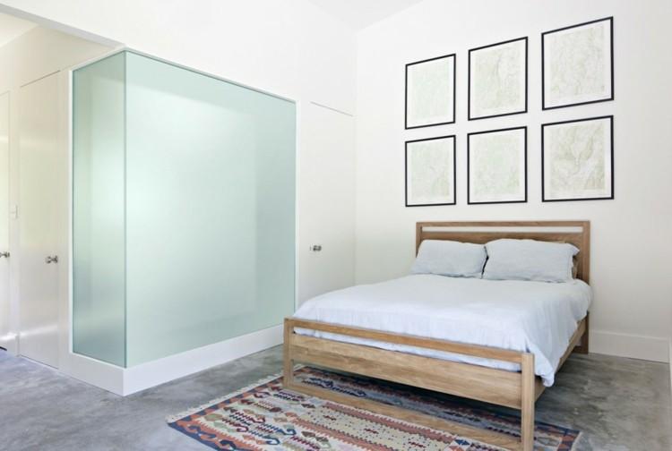 minimalismo cama madera alfombra nordica