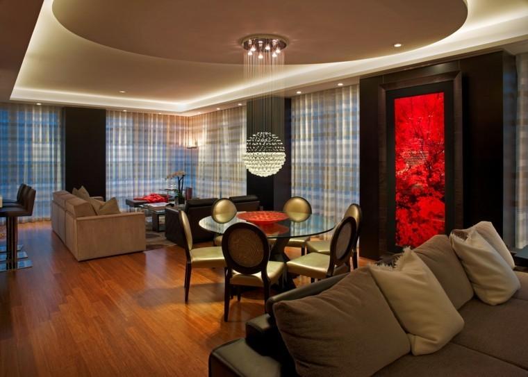 salon comedor sillas mesa redonda lampara preciosa