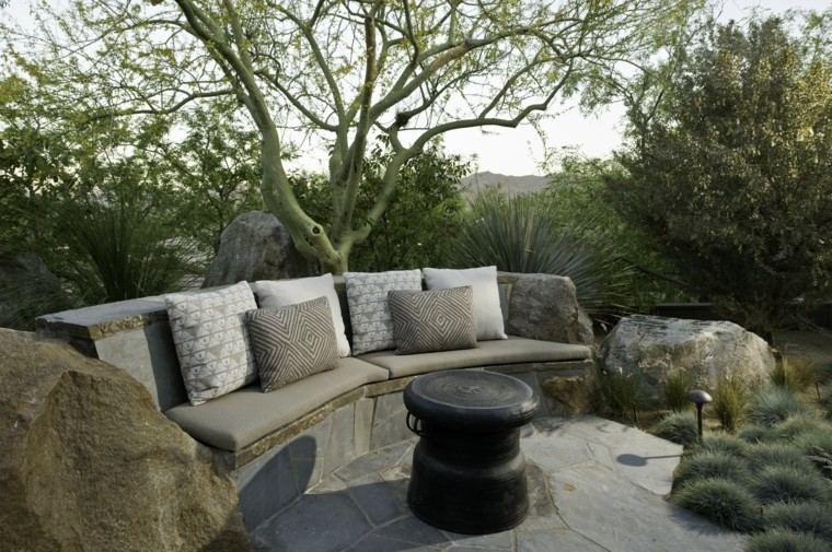 Mesas de piedra para exterior portafolio argopin forjados for Sofa exterior plegable