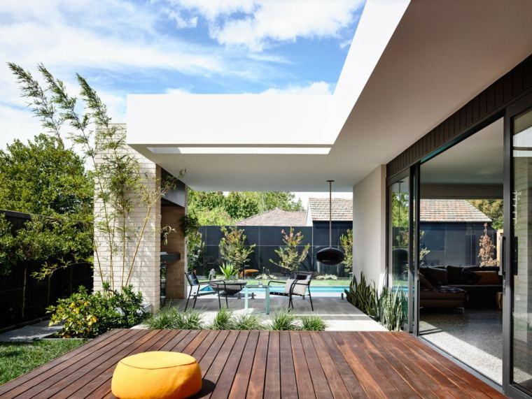 InForm jardin muebles negros suelo madera ideas