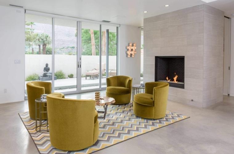 OJMR Architects salon sillones amarillos ides
