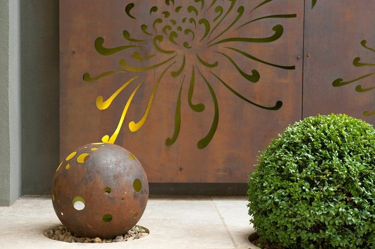 adornos jardin acero perforado oxidado