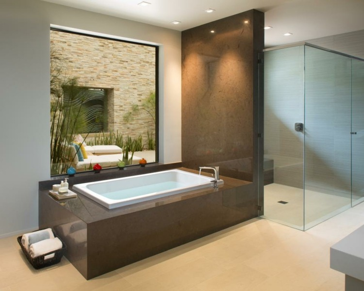 baños con bañeras led iluminacion caminos rocas