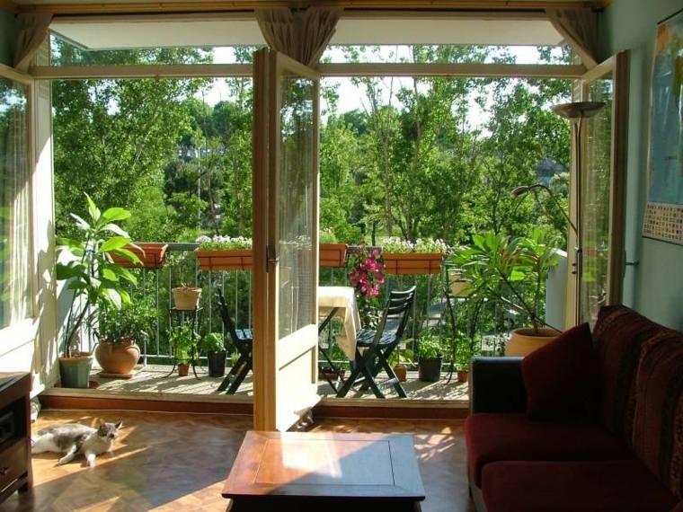 bonita decoracion terraza muebles mesa
