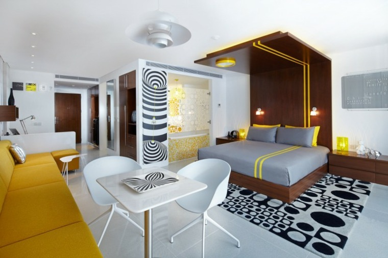 cama moderna cabecero madera techo