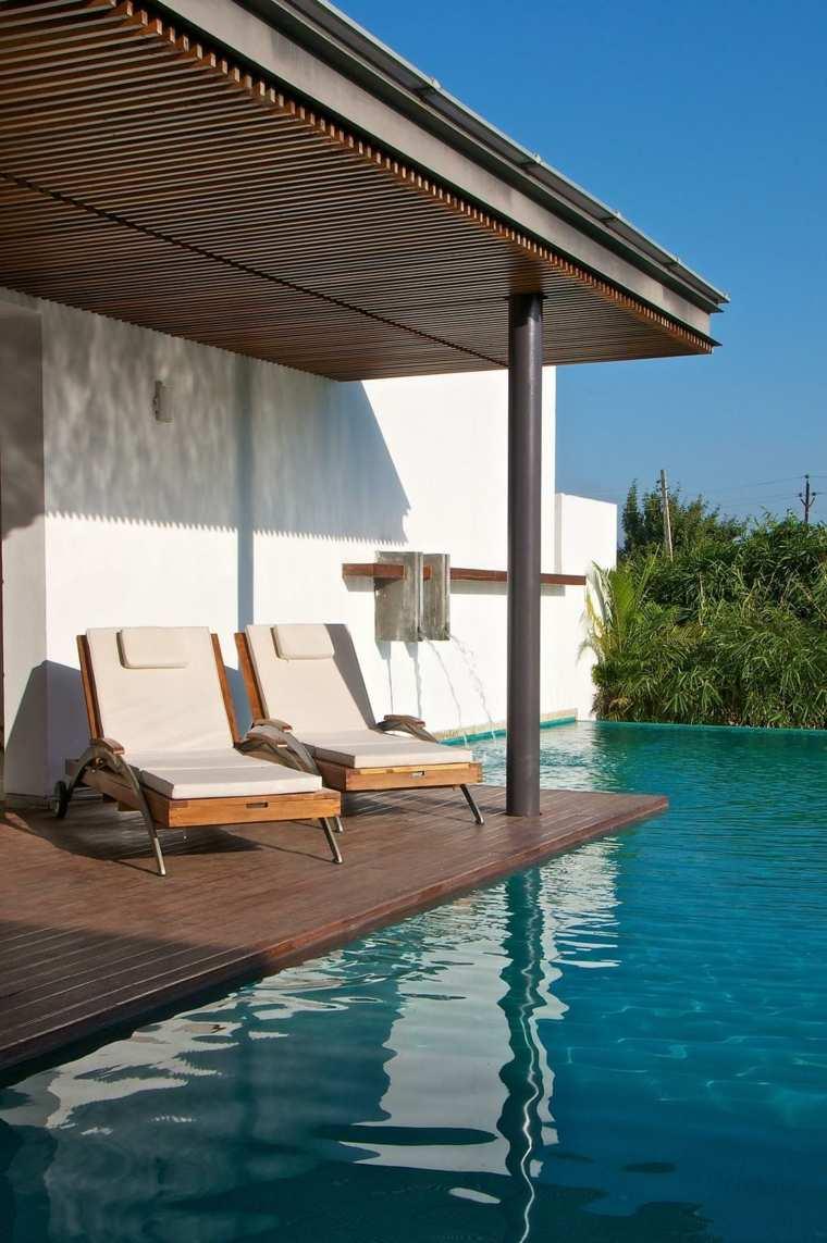 decoracion terrazas piscina tumbonas caida agua ideas