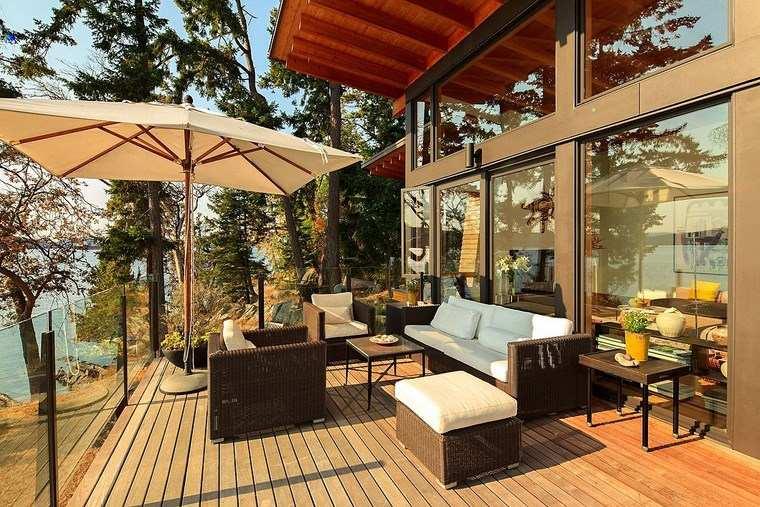 decorar terraza sombrilla muebles mimbre ideas