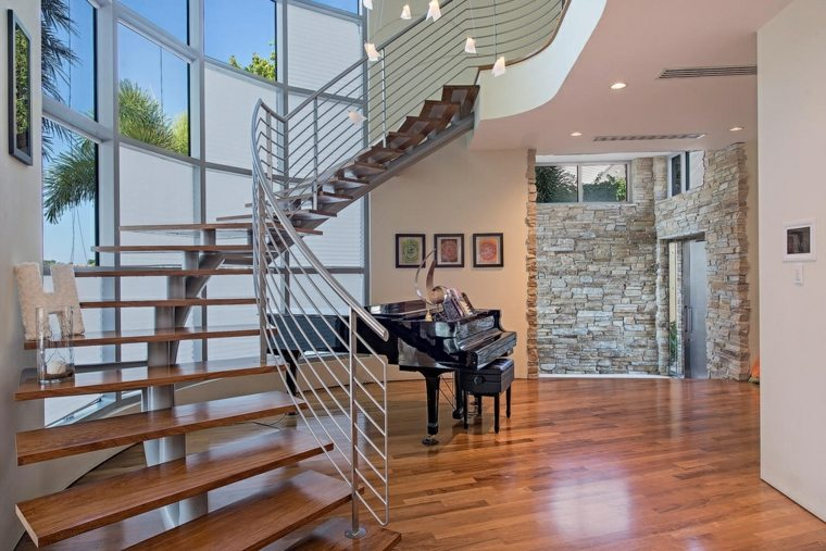Escaleras de interior modernas 50 dise os que marcan tendencia - Como subir muebles por escalera caracol ...