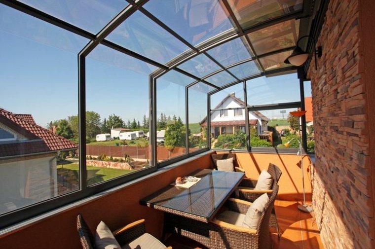diseño terraza techo paneles vidrio
