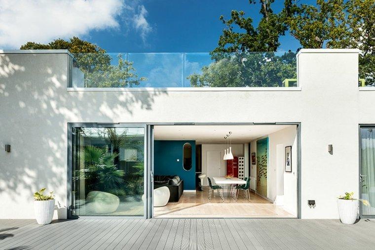 Bauhaus cincuenta dise os de interiores y fachadas for Fachadas casas color arena