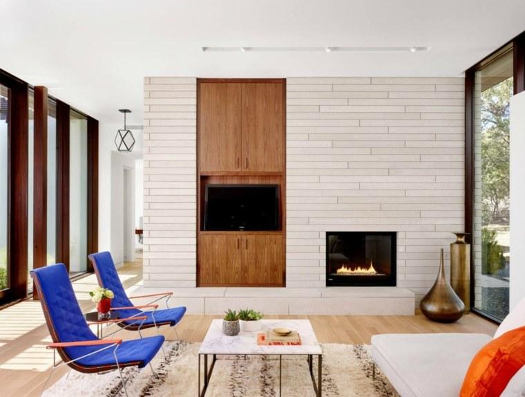 ideas decoracion interiores salones chimenea sillones azules moderno