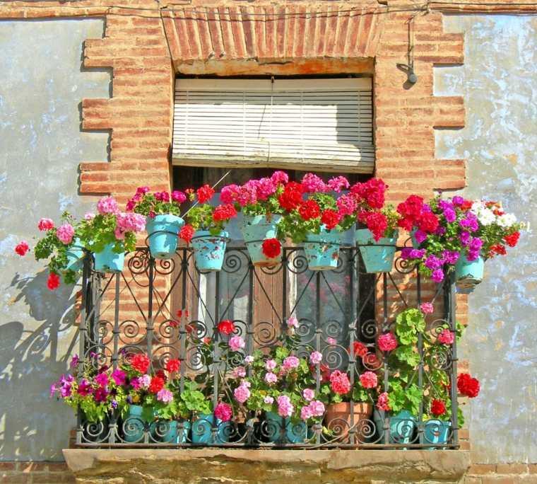 original decoración geranios balcón