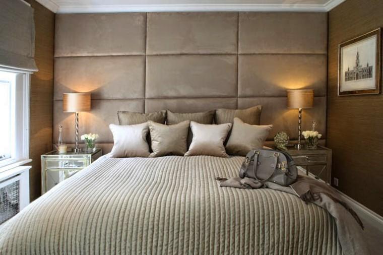 pared acolchada cabecero cama gris