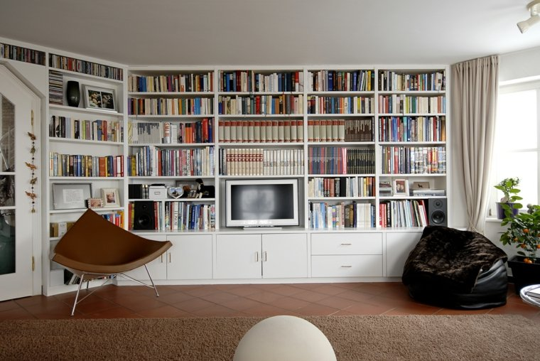 sala estar libros silla moderna
