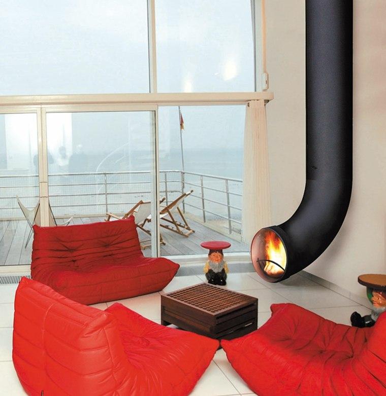 tubo acero chimenea sillones rojos