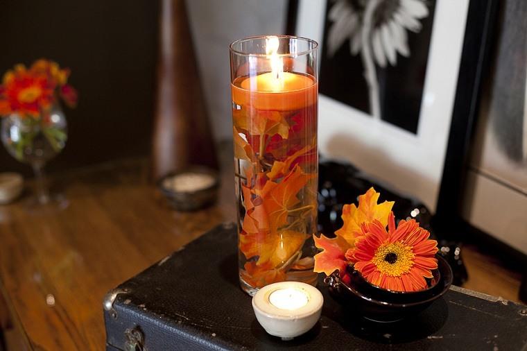 velas flotantes tonos naranja otoño