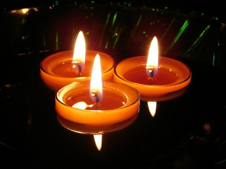 velas flotantes redondas color naranja