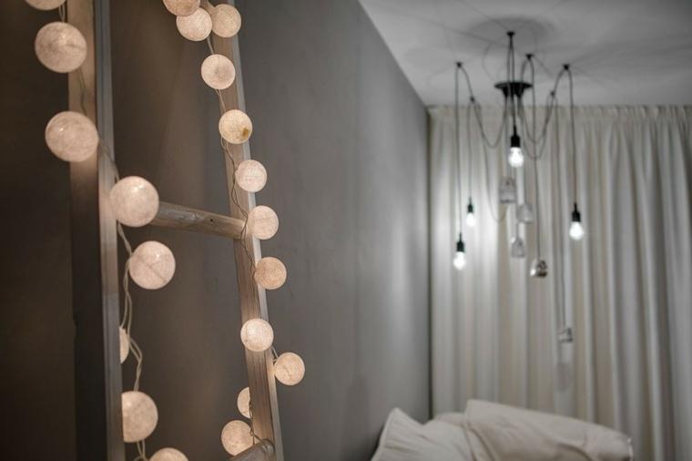diseno monocromatico dormitorio escalera madera guirnalda ideas