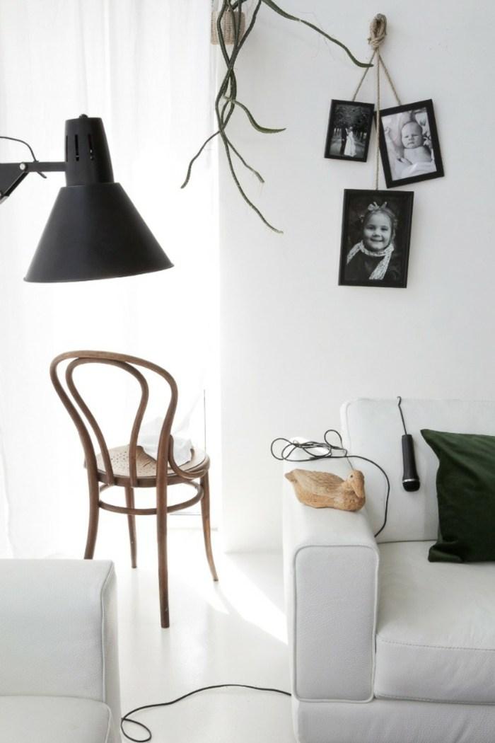 cuadros negros salones muebles sillones verdes