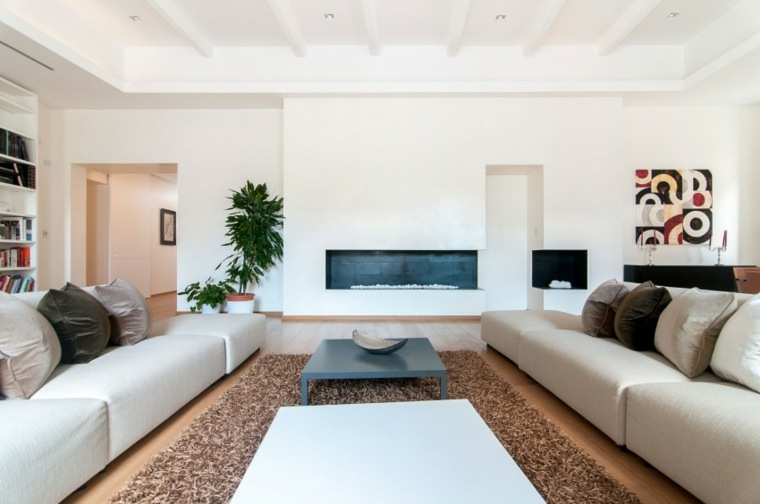 decoración salones modernos chimenea plantas ideas